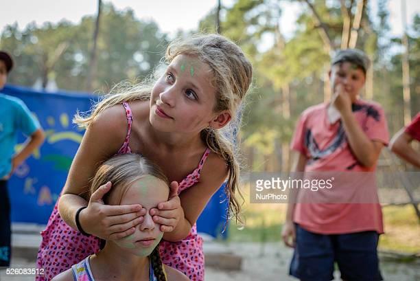 Scouts playing in Ukrainian scout training camp Kiev region Ukraine