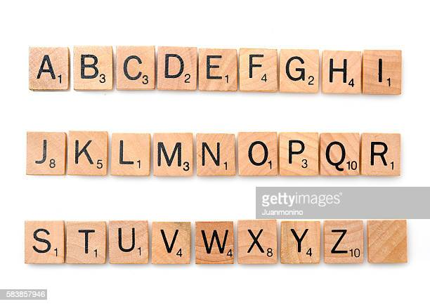 scrabble complete alphabet - text stock pictures, royalty-free photos & images
