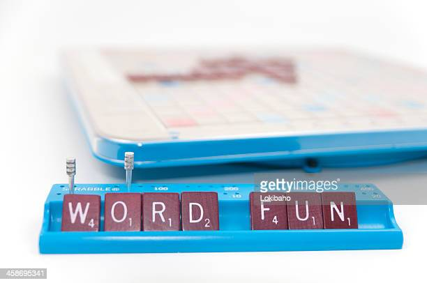 scrabble game is word fun - game night stock photos and pictures