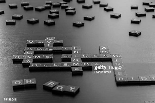 CONTENT] Scrabble tiles arranged to show various words representing the word 'puzzled'