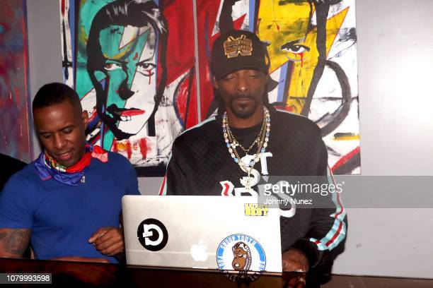 Scram Jones, DJ Whoo Kid, and Snoop Dogg spin at the Barry Mullineaux Birthday Celebration at Pomona on January 9, 2019 in New York City.