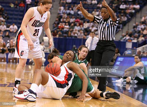 A scramble for a loose ball between UWGB and UCONN during the NCAA Tournament second round game at the Hartford Civic Center in Hartford Connecticut...