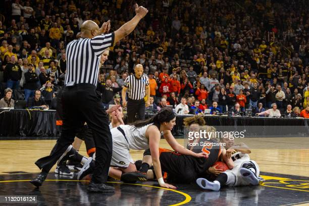 A scramble for possession between Iowa Hawkeyes guard Tania Davis and Mercer Bears forward Amanda Thompson results in a jump ball call during the...
