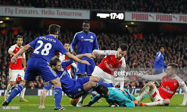A scramble for the ball in the Chelsea penalty area late in the English Premier League football match between Arsenal and Chelsea at the Emirates...