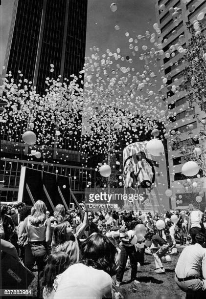 Scramble for the Balloons Children scramble for 30000 helium balloons at the First of Denver Plaza at the opening Monday of Carousel Days to promote...