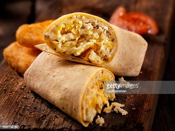 scrambled egg and cheese breakfast wrap - burrito stock pictures, royalty-free photos & images