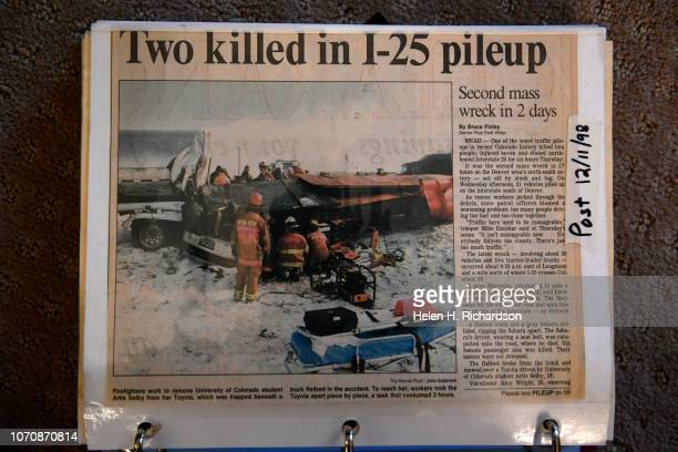 A scrap book holds newspaper articles from 1998 show the wreck that nearly took the life of Artis Jacobsen at her home on December 9 2018 in Arvada...