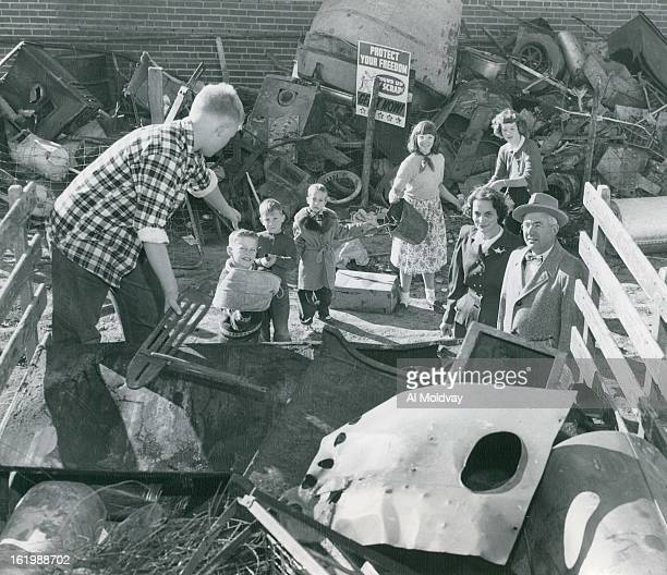 NOV 13 1951 NOV 14 1951 Scrap For National Defense Youngsters at Cherry Hills school collected this scrapsix and onehalf tonsduring a recent drive to...