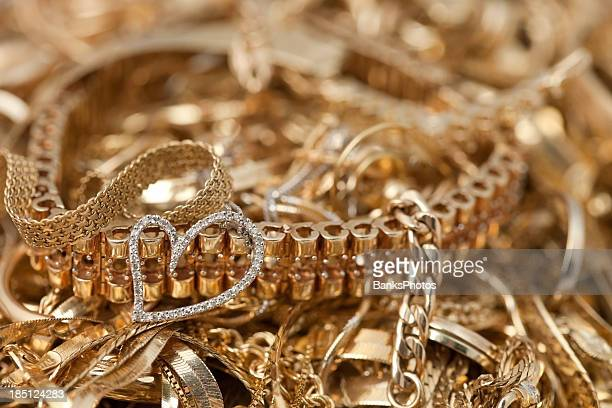 scrap gold pile background with heart - jewellery stock pictures, royalty-free photos & images