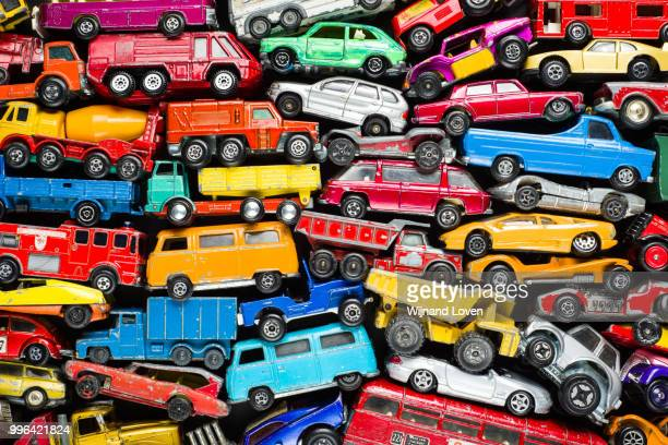 scrap heap of vintage toy cars - collection stock pictures, royalty-free photos & images