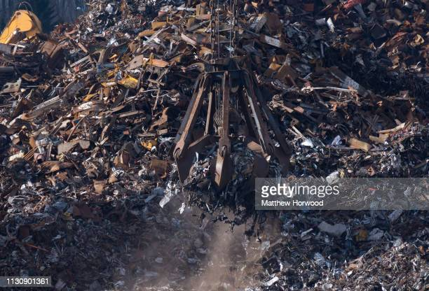Scrap metal is loaded on to the Strategic Vision ship of Singapore using a mechanical grabber at the Port of Southampton on February 10 2019 in...