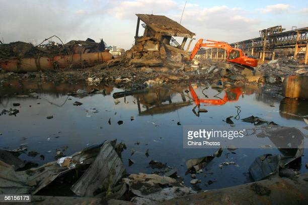 A scraper excavates ruins of the destroyed workshops at the Jilin Petroleum and Chemical Company on November 14 2005 in Jilin City some 100 km east...