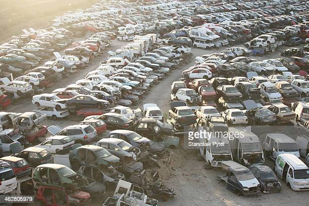 scrap-heap full of cars, top view, sunset - junkyard stock photos and pictures