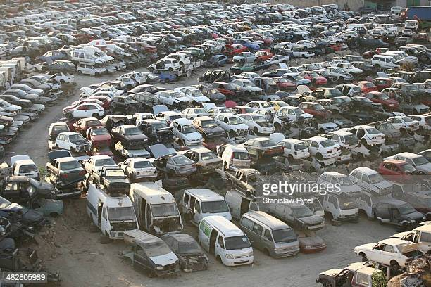 Scrap-heap full of cars, top view, sunset