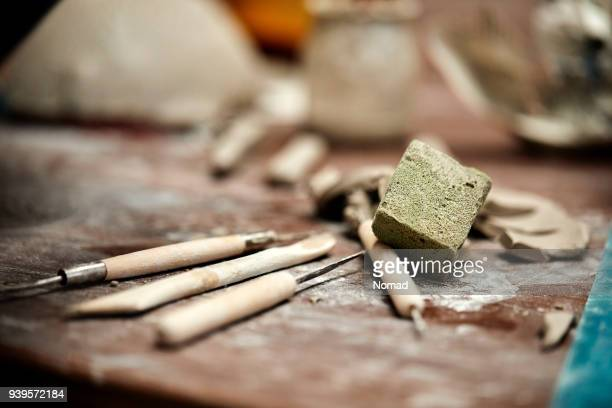 scraping tools and sponge in pottery workshop - pottery stock pictures, royalty-free photos & images