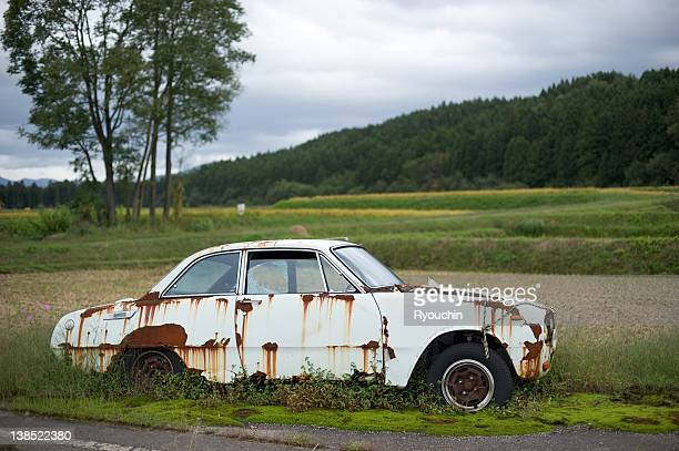 scrapped in the countryside - scrapped cars stock photos and pictures