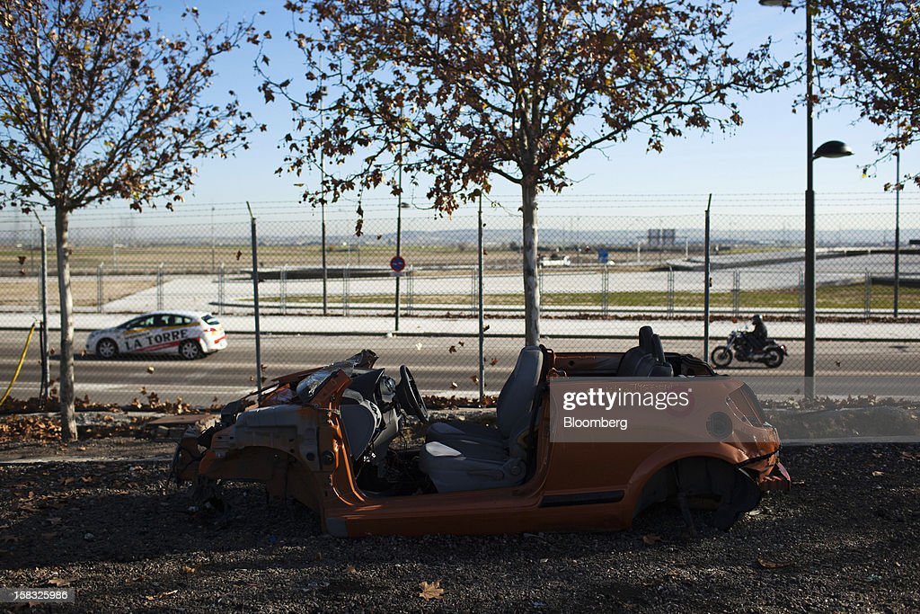A scrapped vehicle used to source spare parts stands in the yard of the Desguaces La Torre scrapyard in Madrid, Spain, on Thursday, Dec. 13, 2012. Spain has completed the debt sales it planned for this year and started raising funds for 2013, buying time for Prime Minister Mariano Rajoy as he decides whether to seek a European bailout. Photographer: Angel Navarrete/Bloomberg via Getty Images