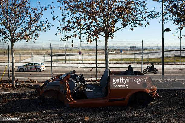 A scrapped vehicle used to source spare parts stands in the yard of the Desguaces La Torre scrapyard in Madrid Spain on Thursday Dec 13 2012 Spain...