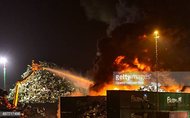 "scrapyard fire in an industrial area at night - ""sjoerd van der wal"" stock pictures, royalty-free photos & images"