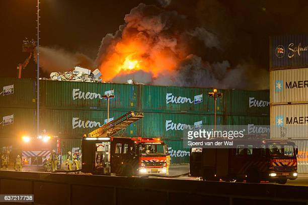 """scrapyard fire in an industrial area at night - """"sjoerd van der wal"""" stock pictures, royalty-free photos & images"""