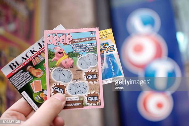 Scratchcard games of 'La Francaise des jeux' games of chance 'Dede' 'Black Jack' 'Millionnaire' and sign of 'PMU' Game addiction National lottery...