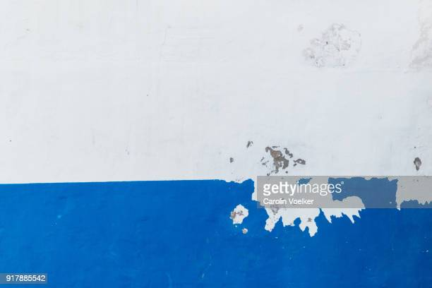 scratched of wall paint in white and blue - mediterranean culture stock pictures, royalty-free photos & images