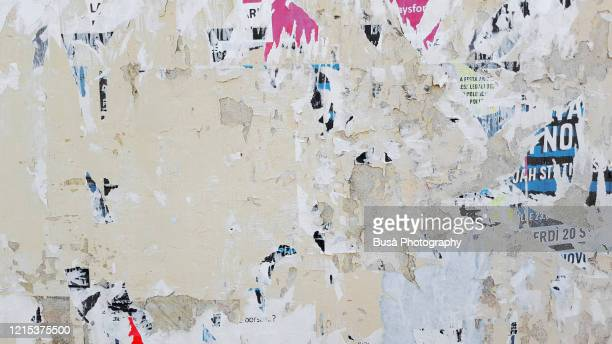 scratched posters on a wall - weathered stock pictures, royalty-free photos & images