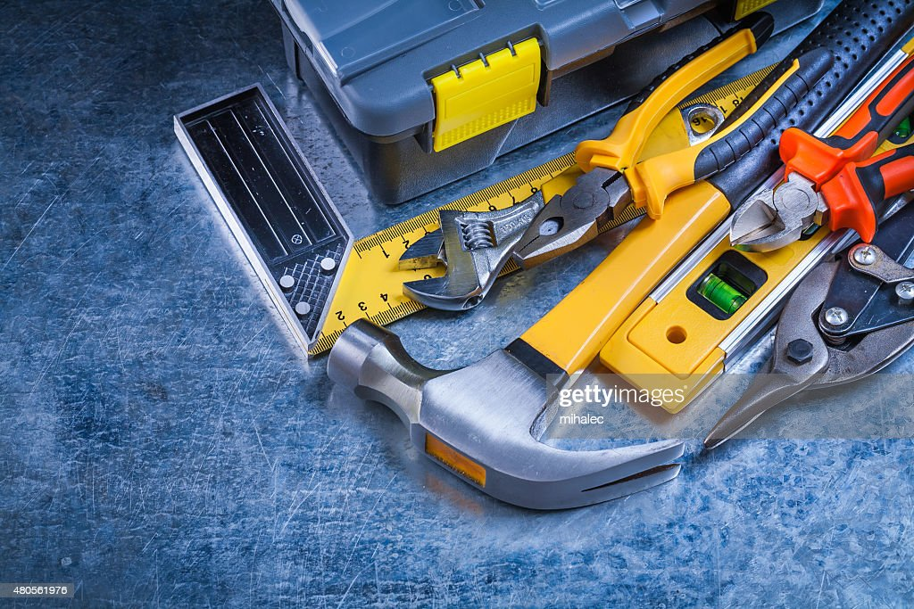 Scratched vintage metallic background with toolbox and toolset c : Stock Photo