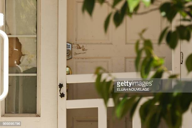 Scratches are seen by the lock on the front door of the home where ten children were allegedly tortured and abused on May 17 in Fairfield California...