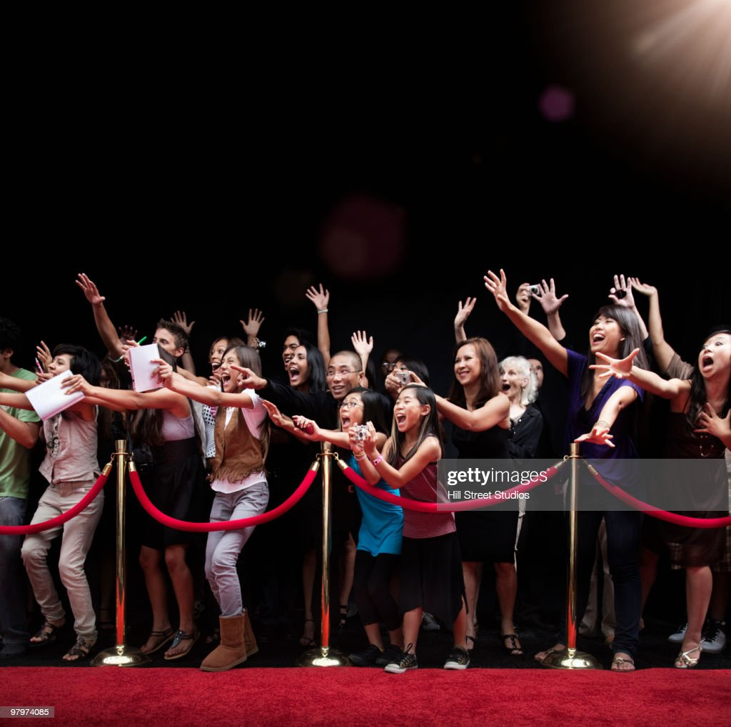 Screaming Fans On The Red Carpet Stock Photo - Getty Images