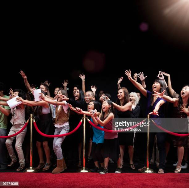 screaming fans on the red carpet - cordon boundary stock pictures, royalty-free photos & images