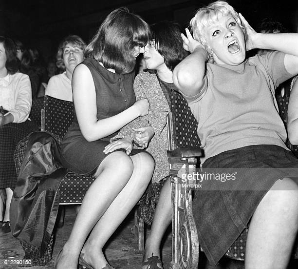 Screaming girl fans greet the Beatles on their appearance at the ABC Cinema in Wigan October 1964 S09149001