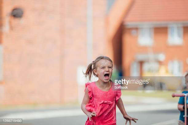 screaming in the street - running stock pictures, royalty-free photos & images
