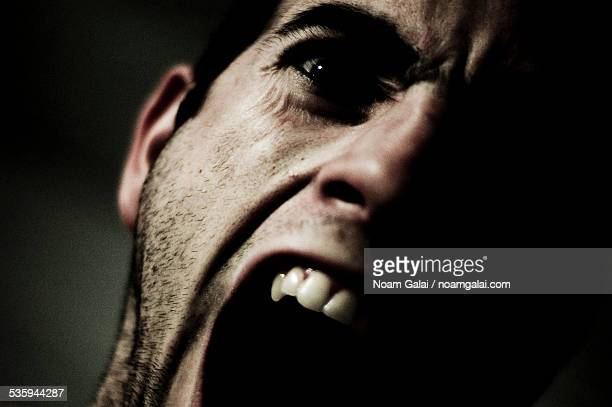 screaming man - scary face stock photos and pictures