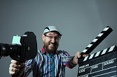 http://www.istockphoto.com/photo/screaming-man-retro-movie-camera-and-clapperboard-gm639306148-115138359