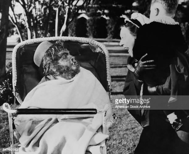A screaming nanny comes face to face with a werewolf in a bathchair in a still from an unidentified film circa 1945