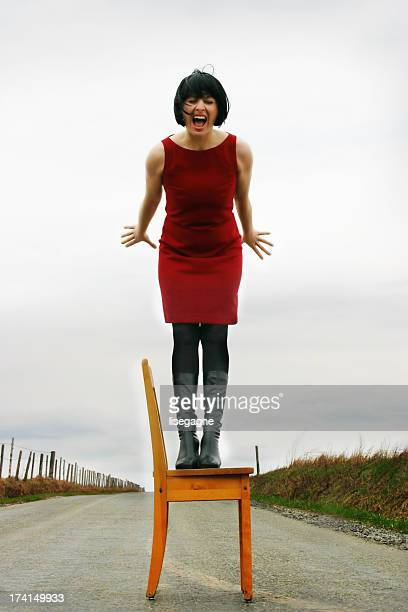 Screaming woman on a chair