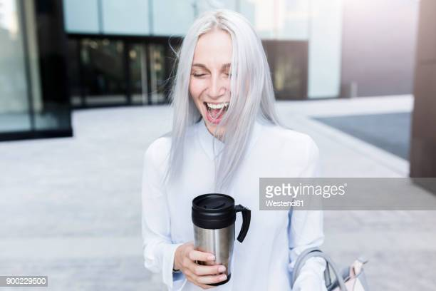 screaming young businesswoman holding coffee mug in the city - gray hair stock pictures, royalty-free photos & images