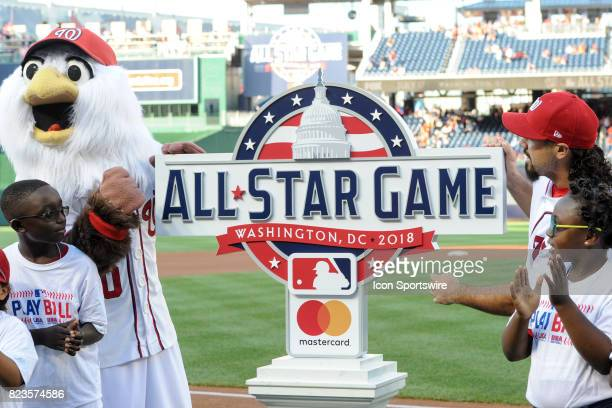 Screech the Washington Nationals mascot and Washington Nationals third baseman Anthony Rendon reveal the 2018 All Star game logo prior to an MLB game...