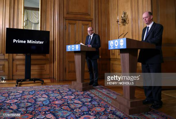 A screen about to show selfisolating Britain's Prime Minister Boris Johnson Britain's Chief Medical Officer for England Chris Whitty and Director of...