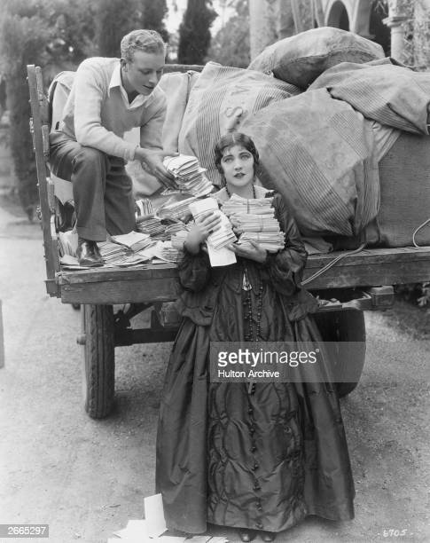 Screen actress and circus performer Renee Adoree receiving her fan mail