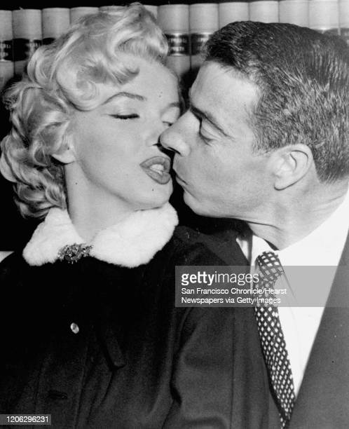 FILE Screen actress Marilyn Monroe kisses Joe DiMaggio as they waited in the judge's chambers for the marriage ceremony which united them November 14...
