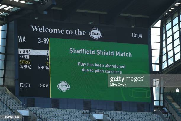 LCD screen announces play is cancelled prior to the start of day two of the Sheffield Shield match between Victoria and Western Australia at...