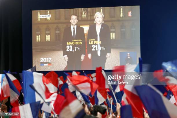 A screen announces the results of the first round of the French Presidential Elections naming Founder and Leader of the political movement 'En Marche...