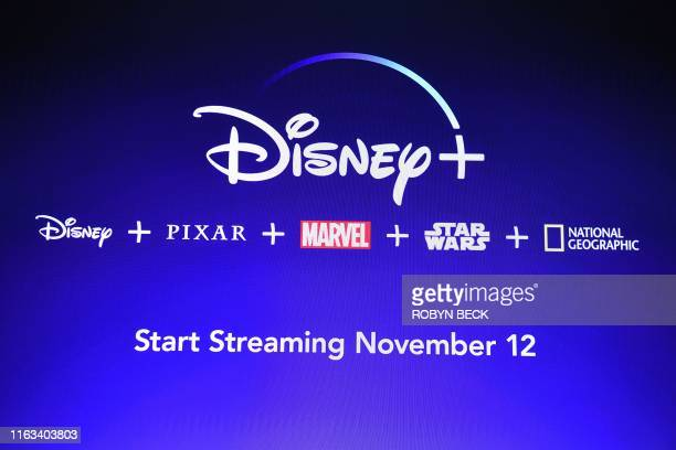A screen announcing the Disney streaming service is seen at the D23 Expo billed as the largest Disney fan event in the world on August 23 2019 at the...