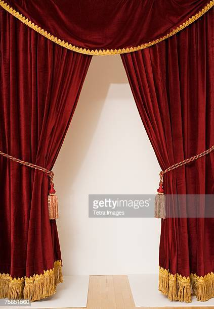 screen behind open stage curtains - stage curtain stock pictures, royalty-free photos & images