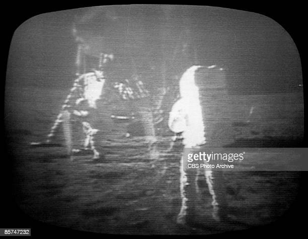 Screen capture from a CBS News Special Report depicts Apollo 11 astronauts near the lunar landing module on the surface of the moon July 20 1969