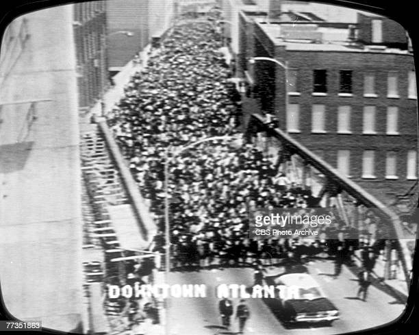 Screen capture from the televised funeral procession of American Civil Rights and religious leader Martin Luther King Jr as hundreds of thousands of...