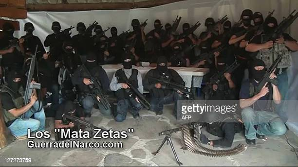 "Screen capture of a paramilitary group which vowed to ""eliminate"" the Zetas, reputedly Mexico's most violent drug gang, in a video posted on the..."