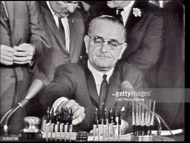 Screen capture of US president Lyndon B Johnson as he signs the Civil Rights Act of 1964 Washington DC July 2 1964